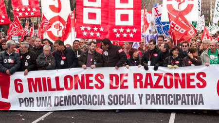simultaneous: MADRID SPAIN - MARCH 10: Demonstration taking place in central Madrid against the cuts in education, social benefits, salaries and health that have been imposed as  solutions to the economic crisis.  This is part of simultaneous country wide protests orga Editorial