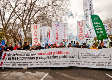 MADRID SPAIN - MARCH 10: Demonstration taking place in central Madrid against the cuts in education, social benefits, salaries and health that have been imposed as  solutions to the economic crisis.  The sign reads in defense of the public services and th Editorial