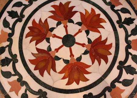 Abstract Rangoli Pattern on Floor photo