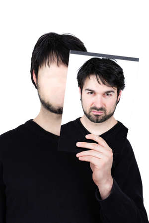 incensed: symbolic image of a man holding his face Stock Photo