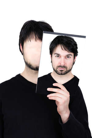 dissociation: symbolic image of a man holding his face Stock Photo