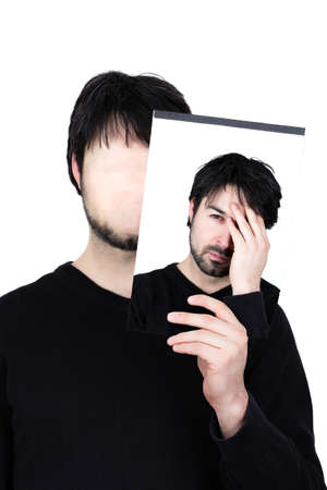 unsound: symbolic image of a man holding his face