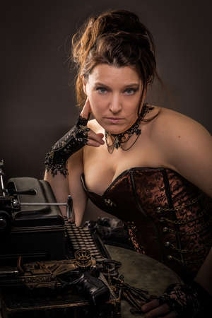 woman in steampunk outfit sitting at a table with a typewriter and a gun pondering photo