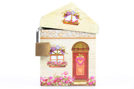heat loss: little house with padlock before a white background