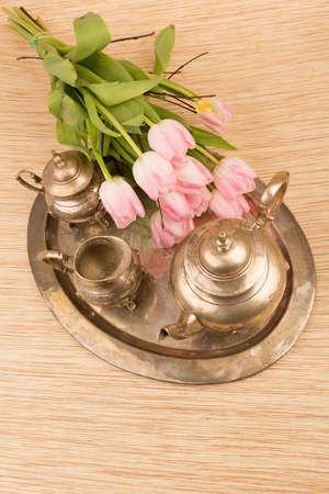 antik: antik table set with pink tulips