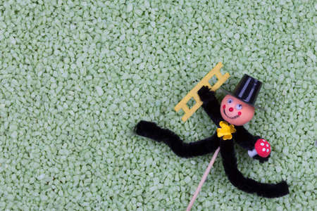 pepples: Chimney sweep luck plug with green pepples background