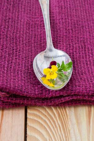 antik: antik silver spoon on a purple fabric