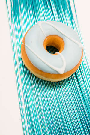 cake factory: pastry on blue decoration against white background Stock Photo