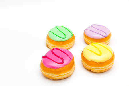 sinful: four pastry pieces with colorful sweet icing Stock Photo