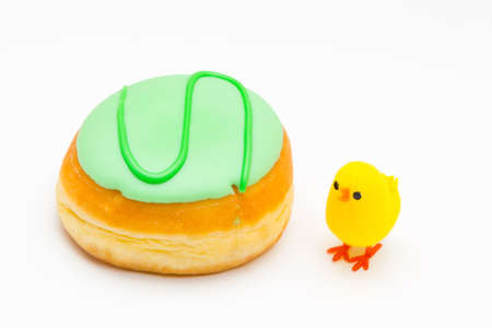 sinful: a pastry pieces with colorful sweet icing and a chick