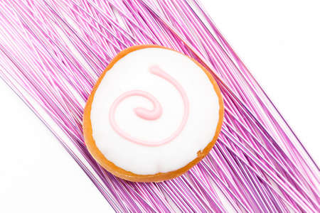 sinful: donut variation on a pink decoration against white