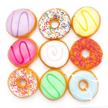 cake factory: colorful set of donuts against white background Stock Photo