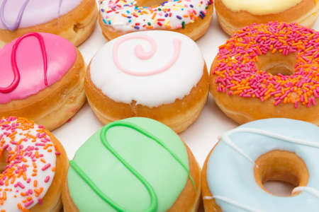sinful: colorful set of donuts against white background Stock Photo