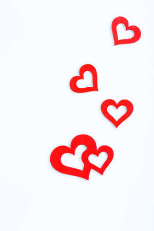 exempted: some red hearts of felt against a white background