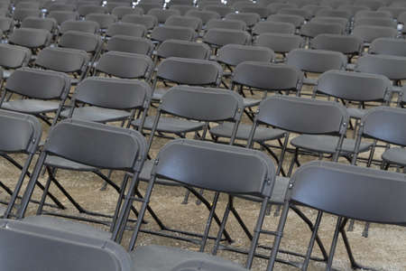 a lot of dark folding chairs Stock Photo