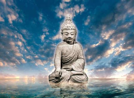 living wisdom: Buddha statue on water