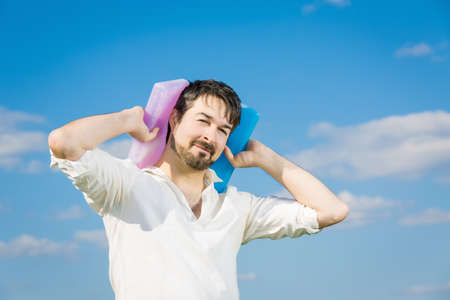sunstroke: man with cooling packs holding against his neck