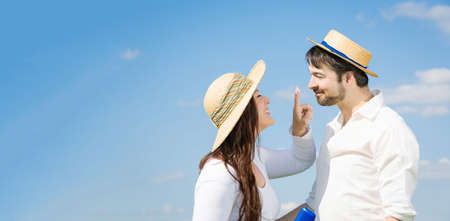 couple against blue sky having fun together Stock Photo