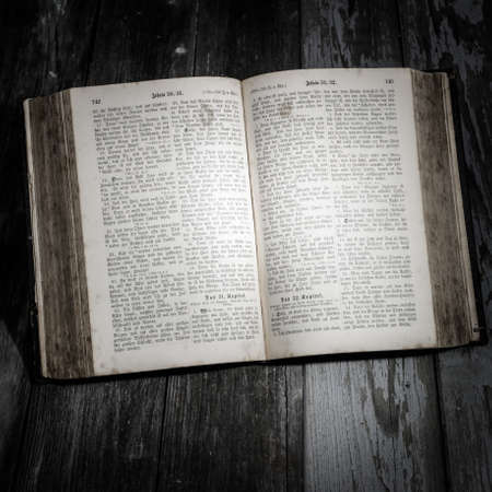 pitched: old german bible, lying open on a wooden table