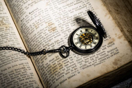 bible with a steampunkt clock as still life for halloween Stock Photo