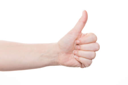 female hand with thumbs up against white background