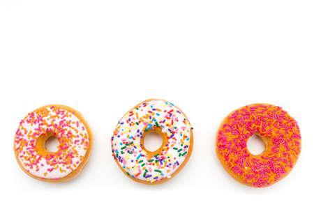trio: colorful donut trio against white background Stock Photo