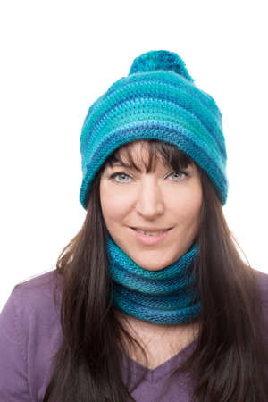self worth: portrait of a woman wearing scarf and hat against white background