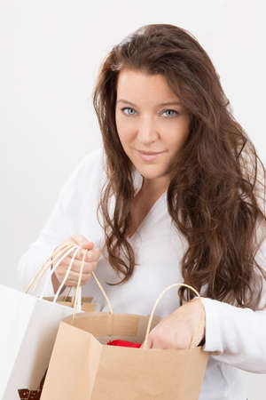 deliberately: woman who controlls her shopping bag Stock Photo