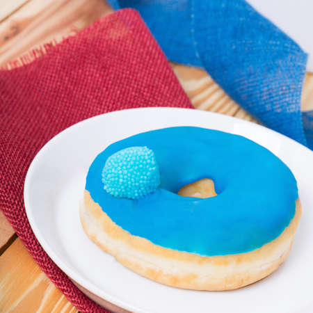 dough nut: sweet delicious blue donut with colorful glaze and a sugar berry