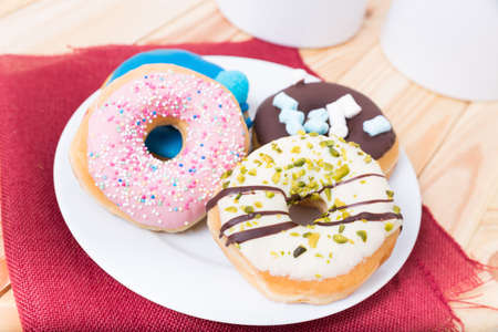 dough nut: a selection of four tasty donuts on a plate Stock Photo