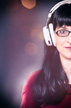 decibel: woman listen to the music of her headphone Stock Photo