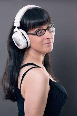 decibel: woman listen to the music of her headphone Stock Photo
