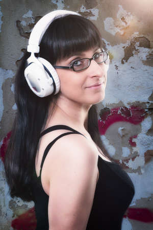 considerate: woman listen to the music of her headphone Stock Photo