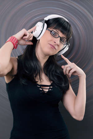 affecting: woman listen to the music of her headphone Stock Photo