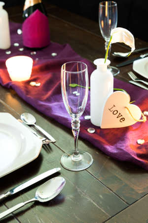 place setting: table with place setting for two persons in violet colors
