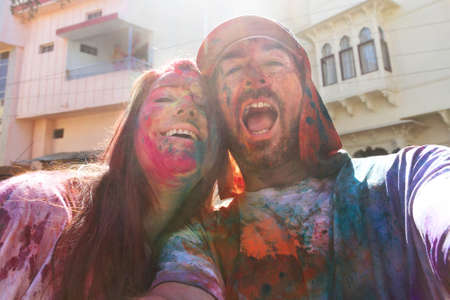 couple having fun and laughing at the holi festival in india Stock Photo