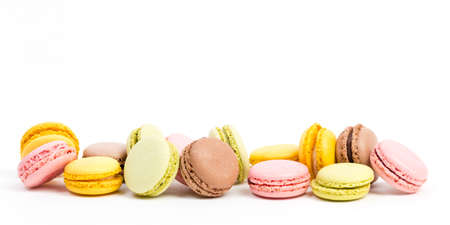 some sweet colorful macaroons against white background