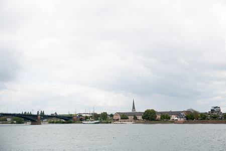 Distant view on the steeple and the buildings at the rhine in mainz germany photographed on a cloudy day