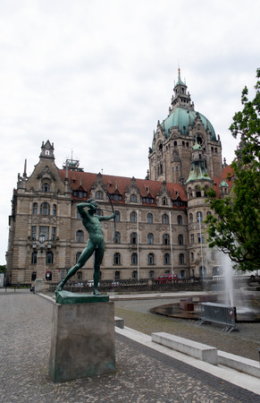 Side view on the new city hall with monument in hannover germany photographed during a walk at a cloudy sunny day