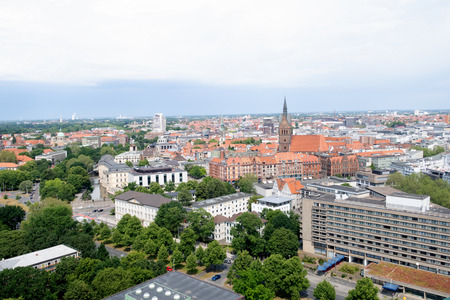View on the buildings from the New Civic Hall tower in Hanover, Germany. Photographed during a walk at a cloudy sunny day