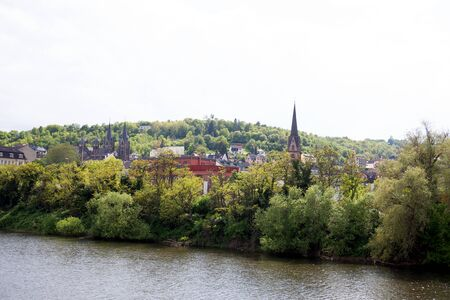 View on the steeple and buildings near the rhine in bingen at the rhine in hesse germany photographed on a cloudy day