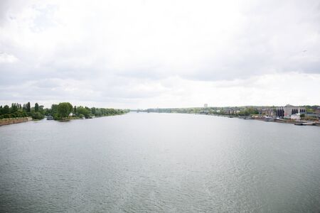 View on the rhine and cloudy sky at mainz germany photographed on a cloudy day