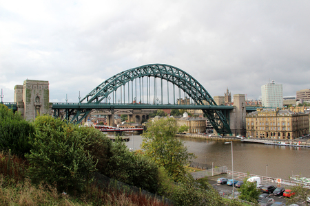 Distant view on a bridge and the river Tyne at Newcastle in North East England. United Kingdom. Photo taken during a sightseeing tour in Newcastle