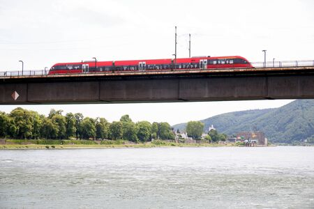 View on a bridge along the rhine river in Koblenz. Rhine and surrounding photographed during a sunny day Imagens
