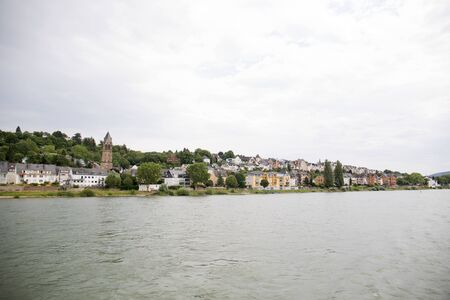 Distant view on a building exterior in Koblenz. Rhine and surrounding photographed during a sunny day