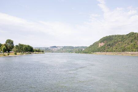 Distant view along the rhine river in Koblenz river rhine and surrounding photographed during a sunny day Imagens
