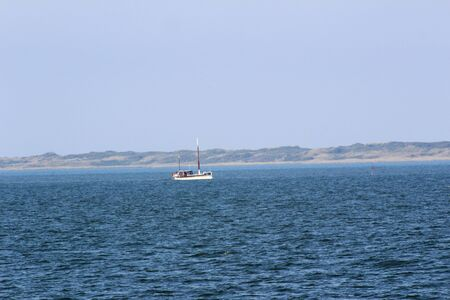 View on sea and land on a blue sky on the northern sea island Imagens