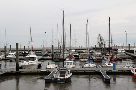 View on the Ships at the Harbor on the North Sea Island. Photographed on a sunny day Imagens