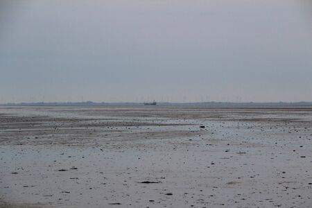 View on the Wadden Sea at the Northern Sea Island. Photographed on a sunny day Imagens