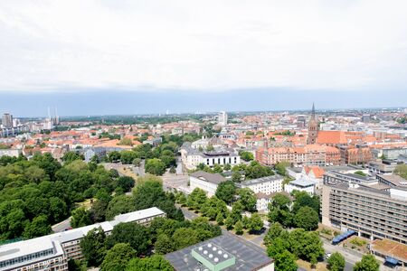 Distant view from the tower of the new civil hall on the landscape and nature in Hanover germany photographed during a walk at a cloudy sunny day